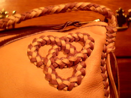 handmade leather handbags custom made using a braided leather construction method