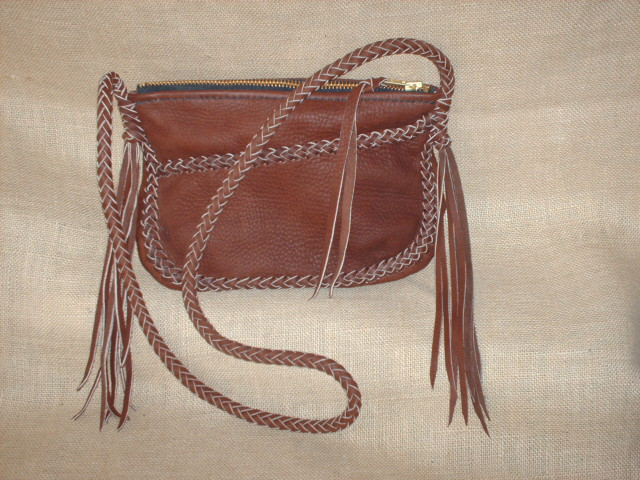 The Clutch Very Similar To One At Left Has A Long Zippered