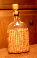 braided leather pineapple knot covered bottle