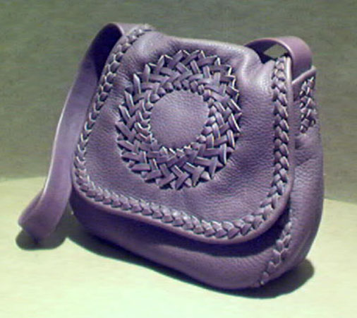f29e22d30fac This handmade purse is made with 4 oz. moccasin cowhide leather. It is  completely