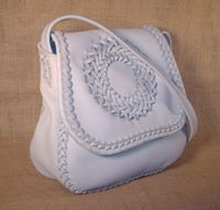 Here is another front angle picture of this braided leather purse using a light colored background.