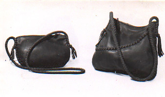 purses that are braided and have long braided leather shoulder straps and zipper closures