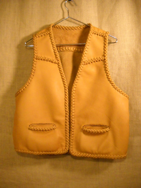 This braided leather vest has front slanted yokes, a back yoke, and two slit hip pockets. Like every thing that I build, it was made in the USA and the moccasin cowhide leather used for it was tanned in the USA.