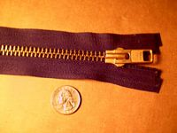 large brass zipper used for leather vests as well as purses and handbags