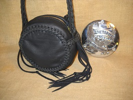 This purse was made to attach that Harley Davidson air cleaner cover on. I think it's a nice style without the cover. The braided strap is quite long ...for being worn cross body - over ones head/shoulder.