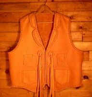 a cowboy leather vests made in a western style