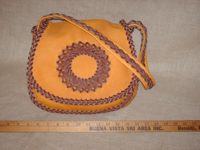 custom and handmade braided leather purse.