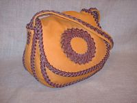 an angled view of this braided leather purse - clickable for a larger view.