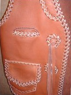 this vest has braided leather conchoes with straps