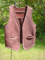 a leather vest with pockets and a back yoke