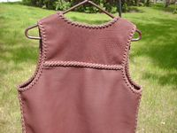 the braided back yoke of this western style leather vest