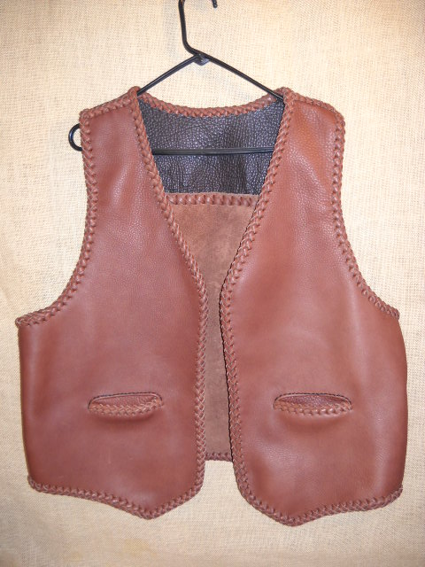 two tone (smooth side out) leather vest with a (suede side out) straight back yoke and slit pockets