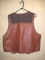 the back side of this two tone brown leather vest
