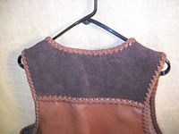 a closer look at the (suede side out) darker brown back yoke of this two tone vest