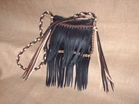This rather small purse has fringe hanging from the front pocket and the bottom of it. It also has tassels on the sides that hang from the ends of the straps that are quite long. I discuss with each customer about how long they'd like their fringe/tassels to be.