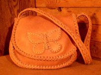 These purse have two compartments under the flap. This one has my butterfly applique on the flap.