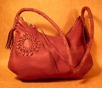handmade leather handbag with a Zia design applique