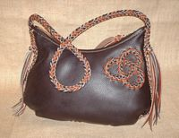 This dark brown and mahogany colored bag has my tri-loop braided applique on one side.
