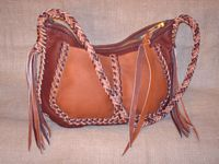 two tone brown leather shoulder bag with a braided leather strap