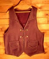 a leather vest withbraided leather closures and front yokes as well as back yokes