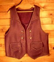 Here is the vest with the 'trick braided' snap closures attached for wearing it with an open front.