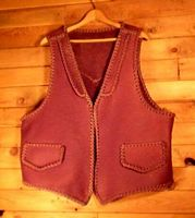 This moccasin cowhide leather vest is completely hand braided. Made in the USA, it has lapels on the front, a pointed yoke on the back, and two slit hip pockets with flaps. Clicking on it will bring you to a page with more details about it.