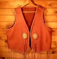 hand made leather vest with custom braided conchoes
