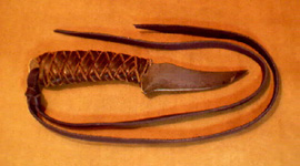 knife handle covered with braided leather
