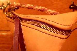 large brass zippers used for custom and handmade braided leather goods.