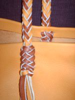 This is a close up picture of one of the strap attachments ...that is also braided.