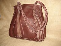 This Mahogany colored large tote was braided using the basic 'stair step' braid. It has quite long 8 strand straps with 8 quite long tassels hanging from them. It also has a full width back/inside pocket.
