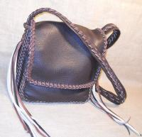 Another braided leather purse for carrying an Apple Ipad - it also has the same two full width pockets as the purse on the left. As usual, the buyer selected the three colors used for it, and the length of the tassels that it has.