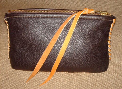 belt pouch made using leather braiding of moccasin cowhide that is made in America