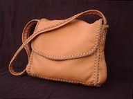 "The dimensions of this large Chestnut colored moccasin cowhide leather bag are about 12.5"" high x 11"" high x 3"". It has a full width pocket on the front under the flap, and a pocket on each side. It also has a large full width pocket on the inside/back. It is completely handmade - no electricity is used in it's construction."