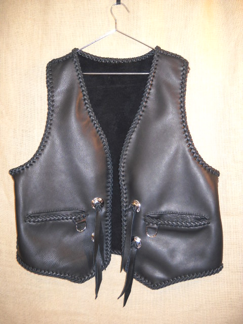 The guy that purchased this vest sent me a vest of his own to get a pattern from. I pretty much add the same features that his vest had. Namely, wide slit hip pockets with a D's hanging from them that he used his own closure on. He also sent me the Harley Davidson conchoes that I add to the vest.