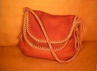 Two more pictures of one of these large shoulder bags. This one made with the Rust color 4 oz. moccasin cowhide leather.