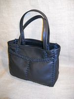 This Black tote was also built using the basic construction of this style - two front pockets, a back inside pocket, and flat straps.