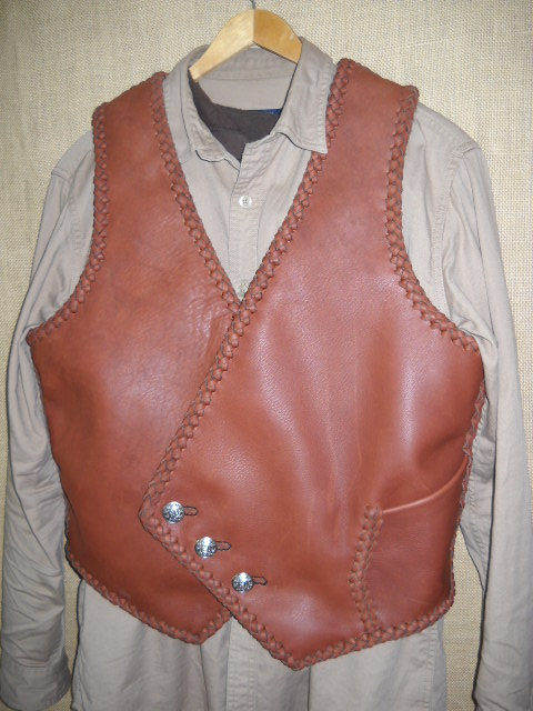 I fashioned this braided leather vest after a picture that a guy want somewhat duplicated. It has the pocket you see in this picture and another similar pocket on the inside - same location. It has the three buttons that the buyer supplied.