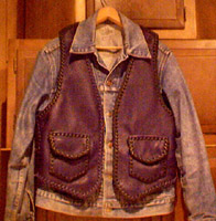 leather motorcycle vest worn over a jacket
