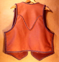 This leather vest that is custom and handmade using braided leather has a yoke on the back of it