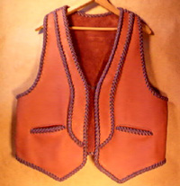 leather vests with lapels, a back yoke, and pockets