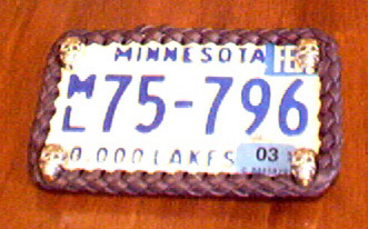 license plate framed using braided leather