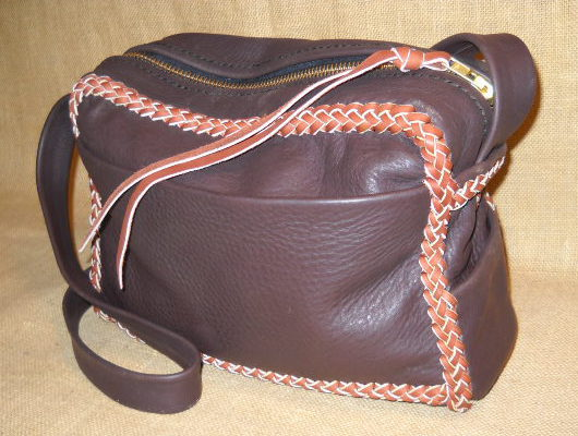 "This two-tone messenger bag is about 12"" wide by 10"" wide by 4"". I like the fact that these wider than high bags have a longer zippers. This bag has four pockets - three on the outside (front and sides) and one on the inside back. The 36"" long strap on this one is not braided."