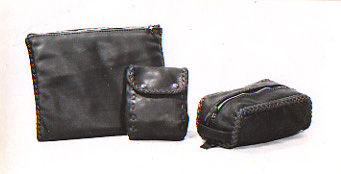 leather accessories including portfolios, belt pouches, shaving kits handmade with braided leather seams