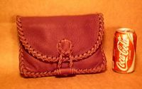 small braided leather handbag with a zipper and a flap