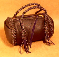 small leather handbags made using braided leather construction