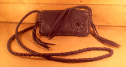 small leather purses made with braided leather construction
