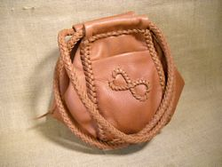 I once saw a purse similar to this style and thought it was unique, hence the name of the page it's linked to. This one has the 'infinity hearts' applique on the pocket.