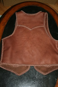 This picture shows the back of the vests, including it's pointed yoke.