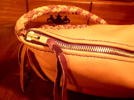 leather handbags with large brass zippers for closures